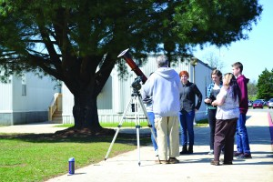 PAC members llooking at a sun spot on April 25 with help of retired NASA Goddard employee David Clark.