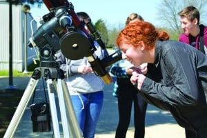 Freshman Anna Blanco uses a telescope to see the sun spot.