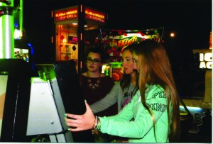 Alumna Allie Fleming, Christina Emory and senior Paige Powell playing at Dave and Busters